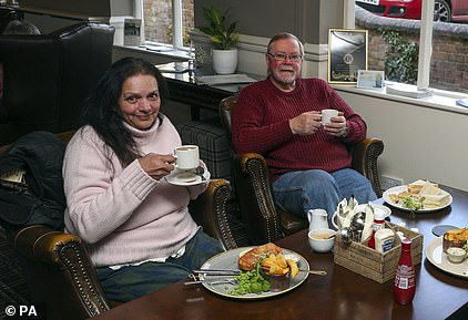 Jennifer Alexandra and Alan Cambridge enjoy their lunch at the Valley Hotel near Ironbridge today after being evacuated