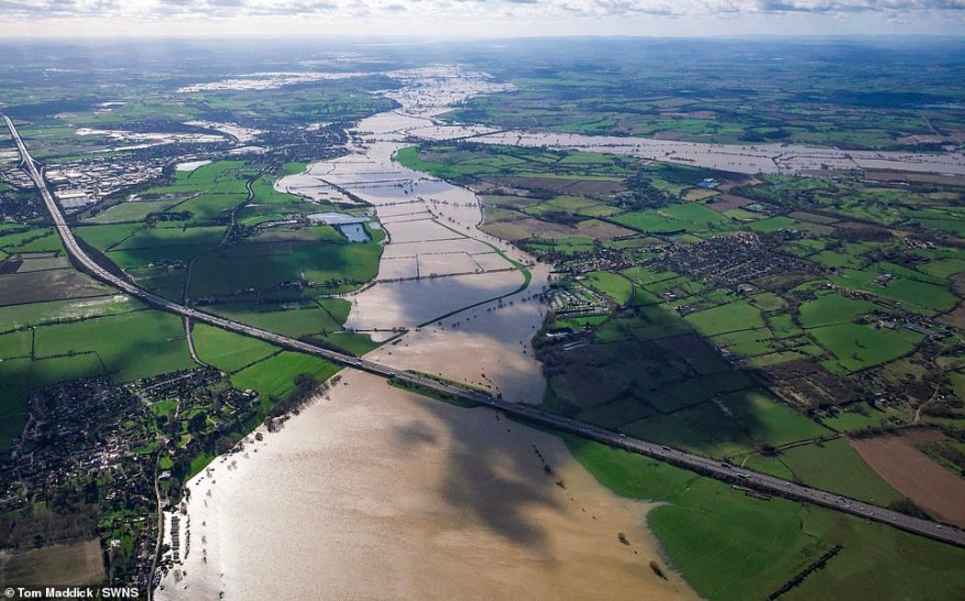 The M5 crossing the River Avon, with Tewkesbury, Gloucestershire (top left) and the Severn branching off to the right, today