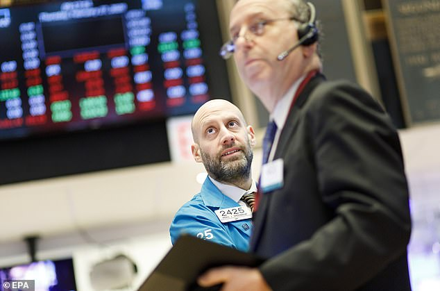 Traders work on the floor of the New York Stock Exchange as investors brace for a possible market correction
