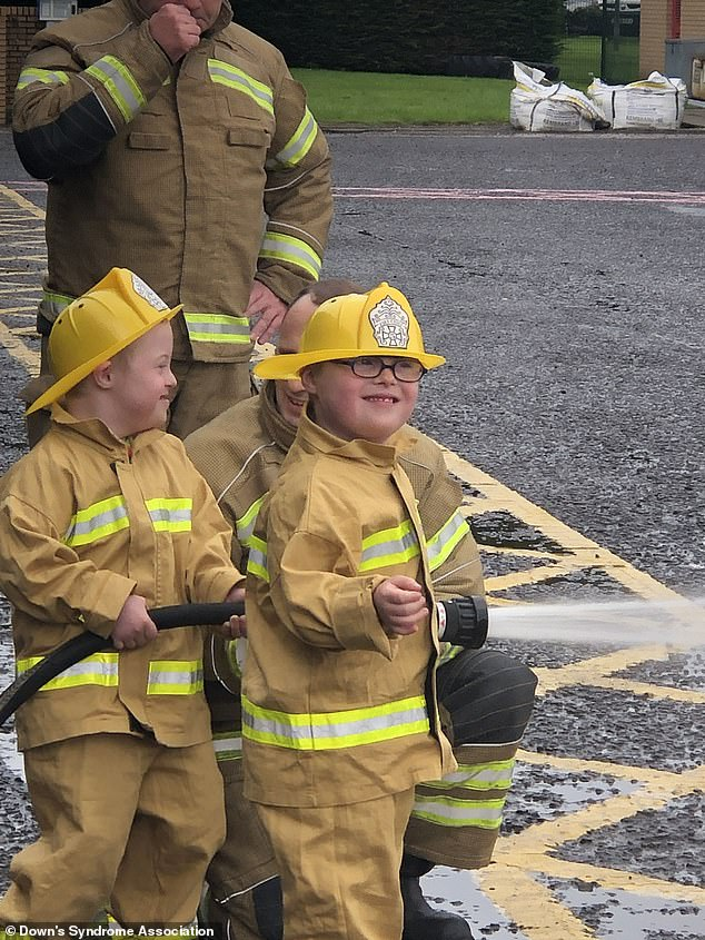 The brothers have starred in a film for the Down's Syndrome Association for their employment programme WorkFit. They are pictured making the video