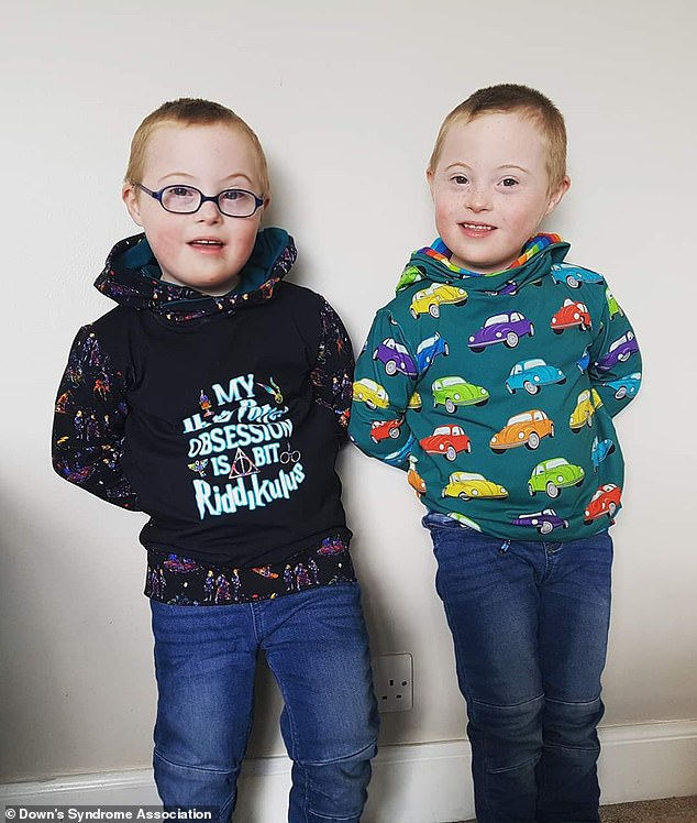 Twins Ollie and Cameron (pictured), six, who have Down's syndrome are internet sensations, boasting over 200,000 followers on Facebook