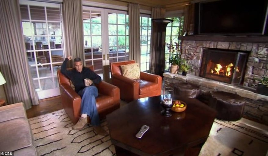 George gave an inside look into his home back when he was still a single bachelor, showing his living room with a fire place and large French doors leading to the outdoor area