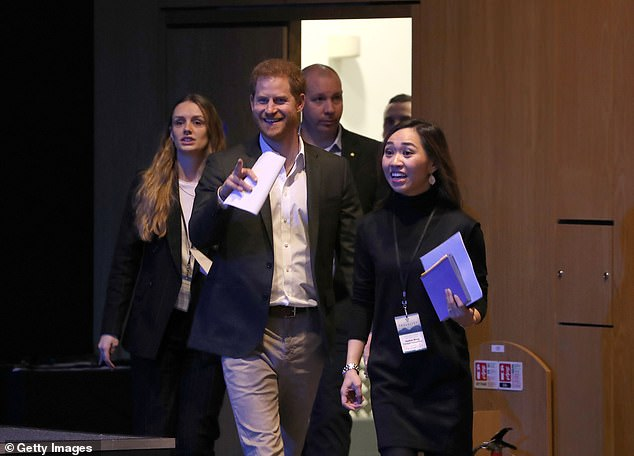 Prince Harry and his bodyguards had an entire First Class train carriage to themselves after he attended a sustainable tourism summit (pictured at the event) in Edinburgh on Wednesday