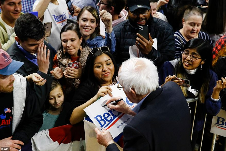 The letters from Bloomberg's doctors come as Sanders has taken the lead as the Democratic front-runner for the party's nomination. Sanders is pictured signing autographs during a campaign event in Spartanburg, South Carolina, on Thursday