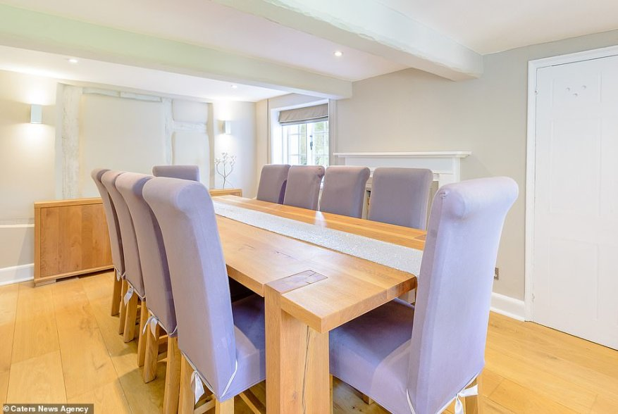 There is also a dining area (pictured) which can comfortably seat ten people as well as a reception room, utility room and a snug