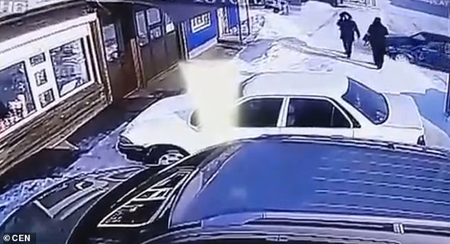This is the moment a car in Russia loses control and is careering towards two pedestrians