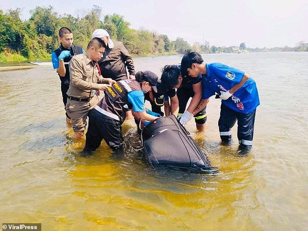 The body of Wang Jun, 30, was found in this suitcase in the Ping river, Kamphaeng Phet, Thailand. Police divers are still searching for his wife Zhu Bing, 28, who is missing