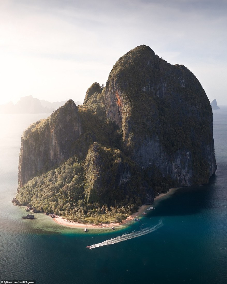 Hong Kong photographer @leemumford8 captured Palawan island in the El Nido municipality in the western Philippines. He said of the shot: 'El Nido had some of the most breathtaking scenery. These huge mountains protruded the ocean creating a landscape like no other. As soon as I saw this island, I knew it would make for some amazing photographs. My girlfriend and I spent a solid hour kayaking against the wind on this island. I wanted to show the insane scale of this place. To help add to the scale, I waited for a boat to leave the beach. Mother Nature is so beautiful when left to her own devices'