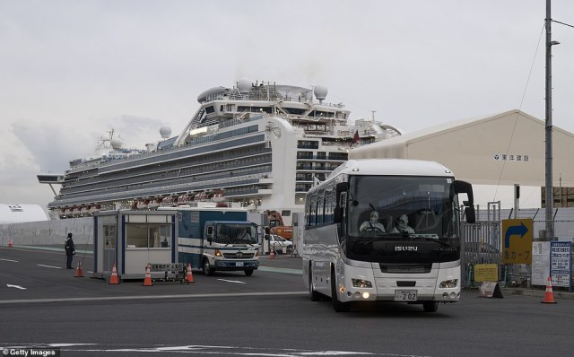 A bus carrying passengers from the Diamond Princess - in this case passengers who were about to be flown home by the Israeli government - drives away from the cruise ship in Yokohama last week