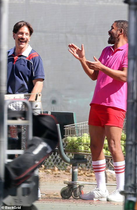 Hot shot: Smith was spotted laughing on set alongside Jon Bernthal , who plays Williams' coach Rick Macci