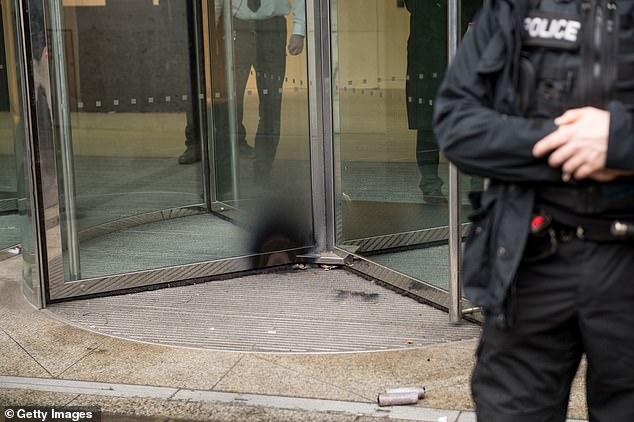 Firework damage seen on a door as protestors from the Green Anti-Capitalist Front clashed with police at the Stock Exchange