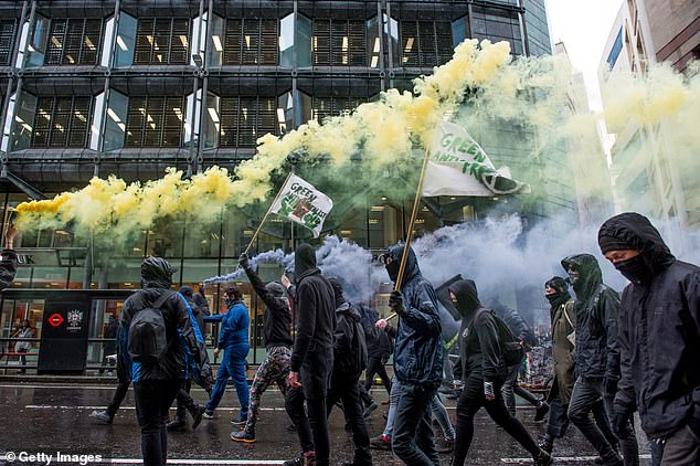 Protesters marched through the streets with flags and let off colourful smoke as they walked