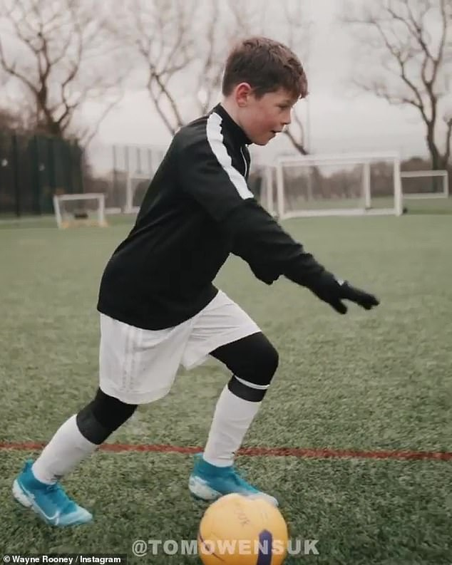 Mini me: Wayne Rooney was thrilled to see his 10-year-old son Kai following in his footsteps and pursuing his own love for football during a recent training session