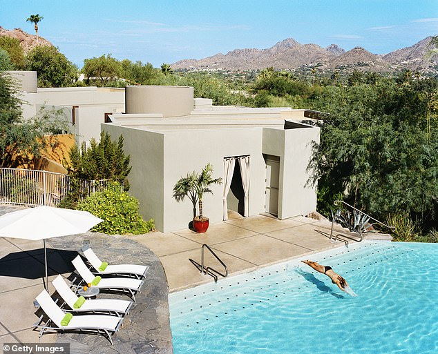 Rodeo dive: Taking a dip at Sanctuary Camelback Mountain hotel, pictured, where Jay Z and Beyonce spent their honeymoon