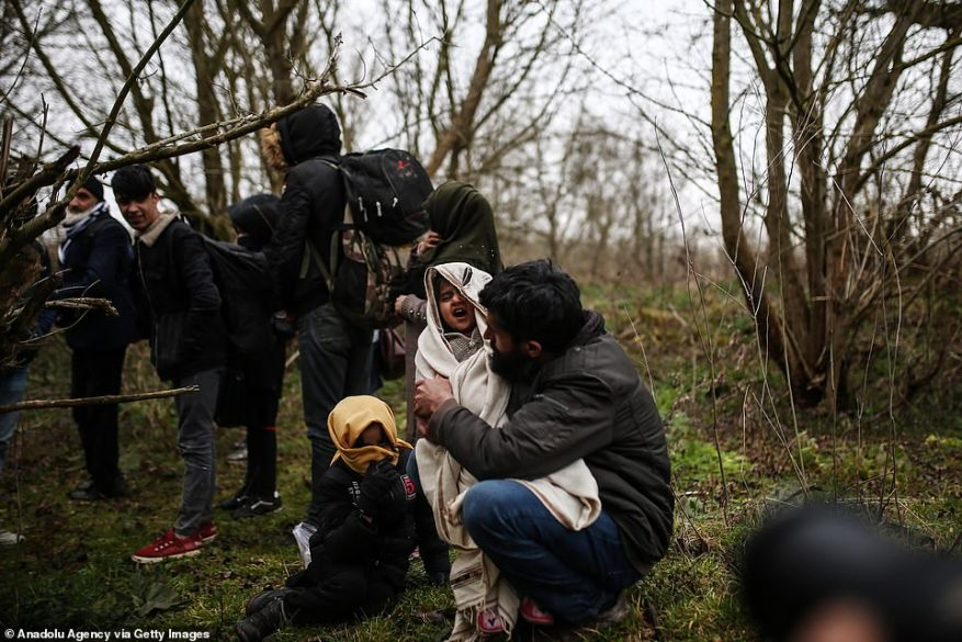 A Syrian migrant family, whose boats were flooded, are rescued after being stranded on an islet while trying to reach the Greek side of the Evros River in Edirne, Turkey today. Irregular migrants, including women and children, have been heading towards the border villages of the country's western provinces of Edirne and Canakkale to reach Greece