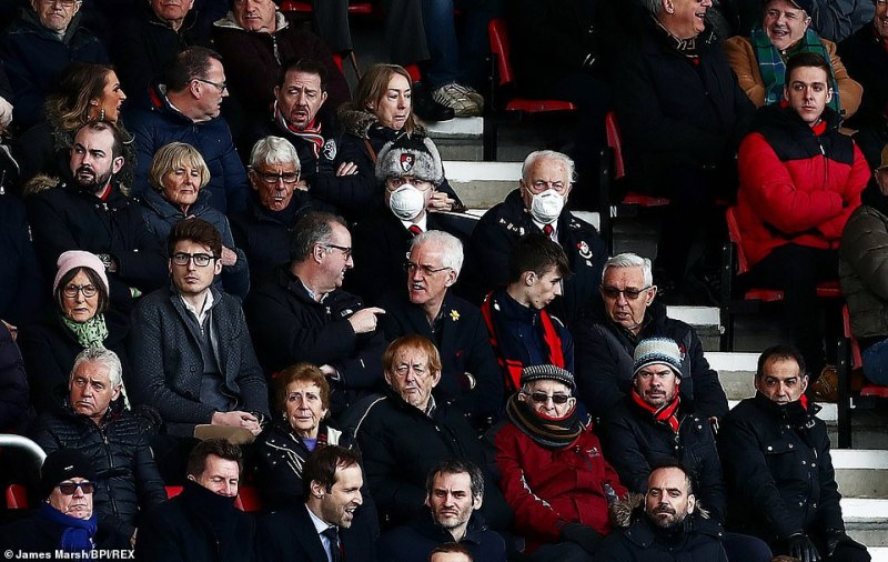 At the earlier match,Bournemouth officials told reporters that the men were wearing the masks as a joke. Pictured: The men at a match yesterday