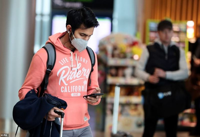 The Republic of Ireland's first case comes as three more patients from England tested positive for coronavirus, bringing the total number of UK cases to 23. Pictured: A man wearing a face mask in Dublin Airport
