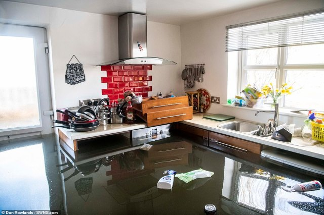 Storm Jorge was the latest in a series which have struck the UK, bringing heavy downpours, 70 mph gales and snow. Pictured: a home inSnaith, East Yorkshire on Sunday