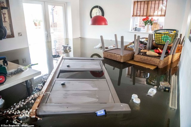 A flooded interior of a home in Snaith, East Yorkshire on Sunday.Flood-hit towns took another severe battering this weekend as February was declared the wettest on record