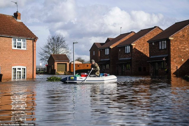 But more than 600 homes and a similar number of businesses in Wales have already been affected by the floods - accounting for around a quarter of properties flooded across the UK. Pictured:Snaith, East Yorkshire