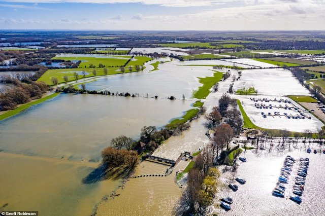 The town of St Ives in Cambridgeshire surrounded by flood water again on Sunday morning after the River Great Ouse burst its banks on Saturday after the rain brought by Storm Jorge