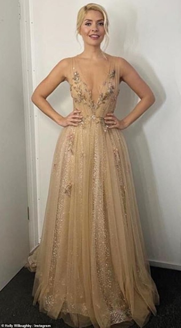 Golden Girl: Holly Willoughby donned what could be her best look as she dazzled in a plunging champagne tulle dress before the Dancing On Ice semi-final
