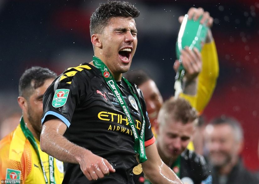 Rodri scored City's second goal with a header and was soaked with champagne as his team-mates sprayed him