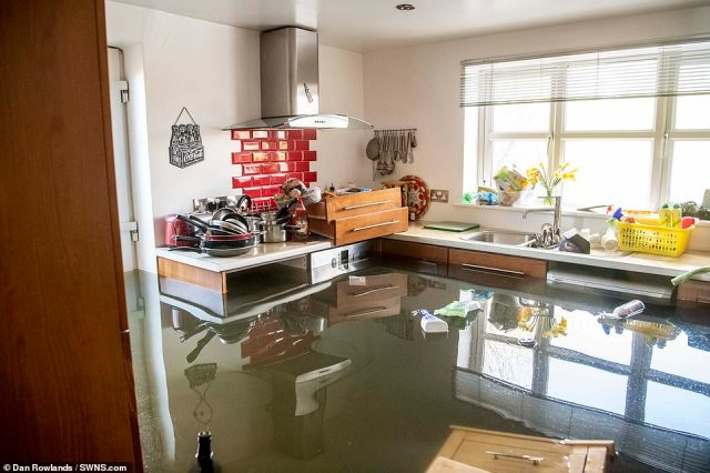 Kitchen utensils and household goods in one house are stored on counters in a bid to avoid the devastating floods that have wrecked homes across the country