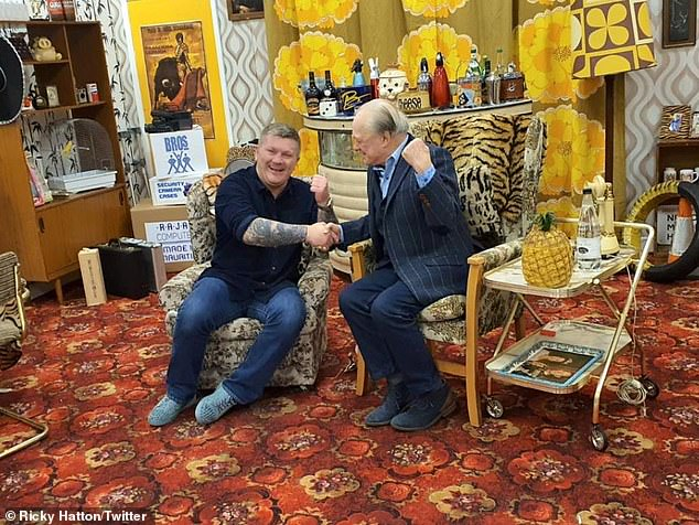 You plonker! Sir David larked around with his fan on set