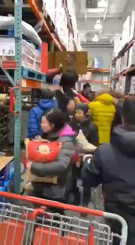 Shoppers stocking up on food at a Costco in Queens