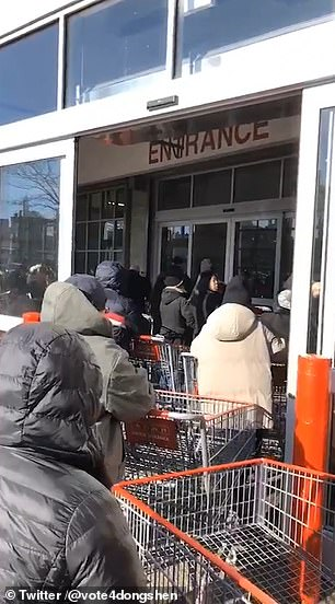 People waited with carts to get inside the store