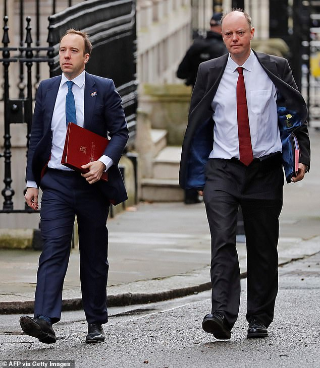 Britain's Health Secretary Matt Hancock (left) arrives at Downing Street in central London this morning with Chris Whitty,Chief Medical Officer for England, foran emergency Cobra meeting