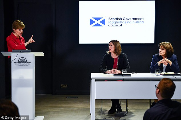icola Sturgeon (left at a press conference in Edinburgh today) dialled into the Cobra meeting earlier. She said 'we are in the containment phase' but the Scottish government was preparing for a 'significant outbreak of coronavirus'