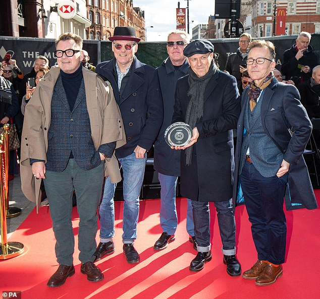Hitting the right notes: In March, Suggs and his Madness bandmates were honoured in their native Camden Townte slab that recognises the band's accomplishments was unveiled on the new Music Walk of Fame