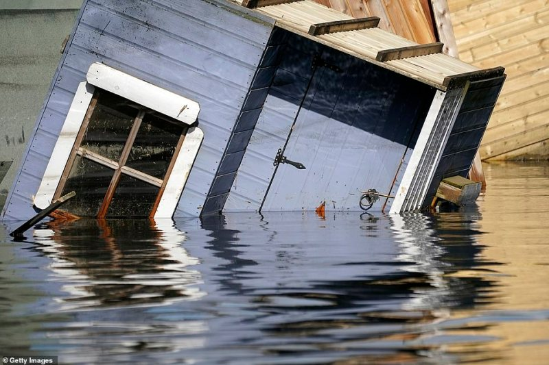 A garden shed is shown floating upside down in Snaith as dozens of homes were almost completely engulfed by floodwater