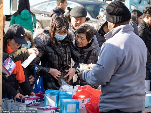 Concerned New Yorkers stocked up on masks and hand sanitizer on Monday after officials confirmed the first confirmed case of coronavirus in Manhattan
