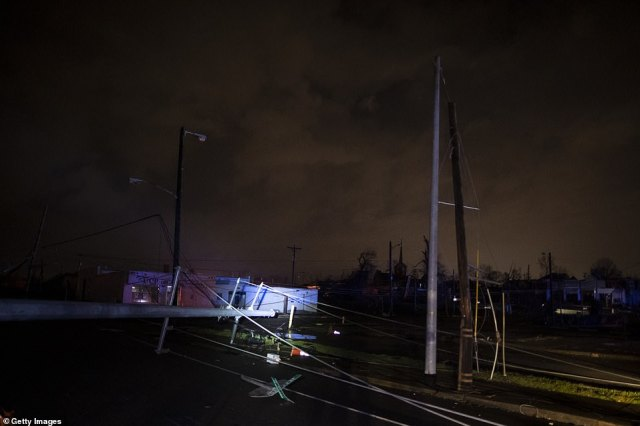 Downed power lines could be seen on Ninth Avenue North in Nashville, Tennessee, today after the 'supercell' struck the city