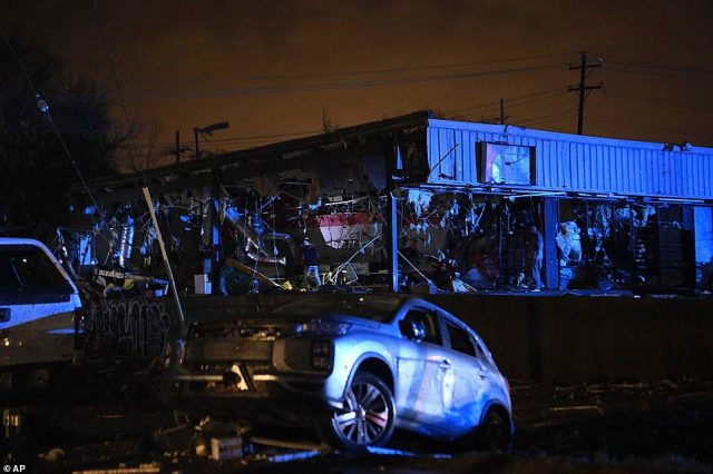 Damamged vehicles and buildings seen in East Nashville after a tornado hit the city in the early morning hours of Tuesday