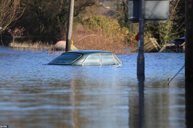 A car submerged in floodwater in Snaith, East Yorkshire, as more than 160 flood warnings or alerts are still in place today