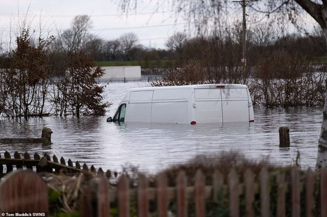 A van sits in floodwater in the deluged East Yorkshire village of Snaith which has been badly affected