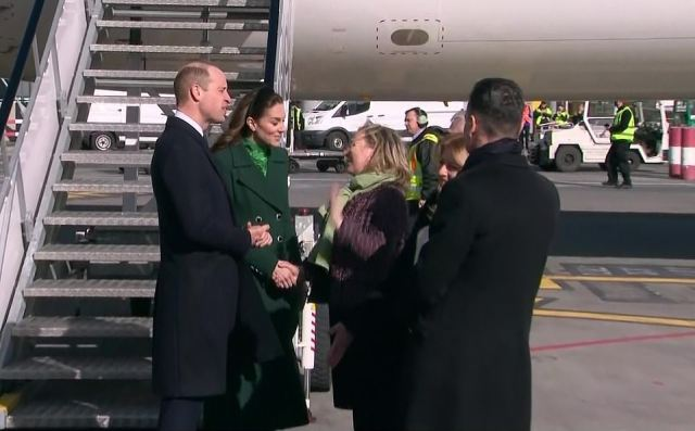 Britain's Ambassador to Ireland Robin Barnett joins dignitaries greeting the royal couple as they walked onto the runway from the aircraft's steps