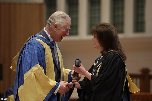 Prince Charles, 71, shakes hands as he presents British composer for film and television Debbie Wiseman with an honorary Fellowship award at the Royal College of Music's annual awards in London