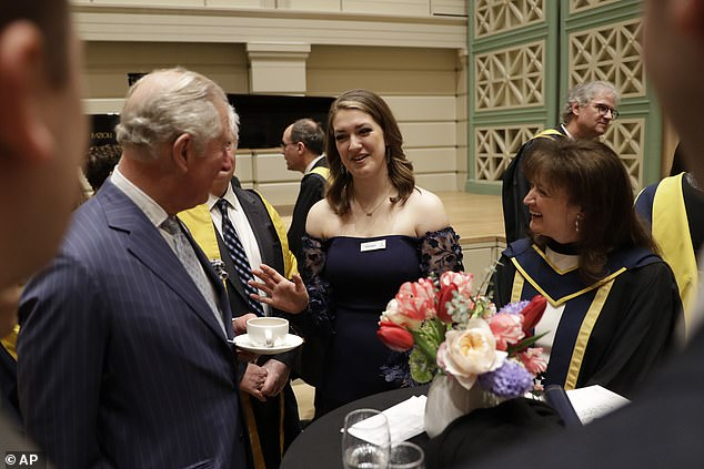 Prince Charles speaks with American student and mezzo-soprano Emily Sierra, centre, from Chicago, and British composer for film and television Debbie Wiseman, right, during a reception in the new Performance Hall