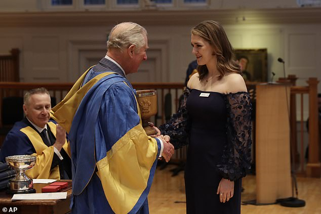 The royal presents the President's Award to American student and mezzo-soprano Emily Sierra, from Chicago, during the awards ceremony