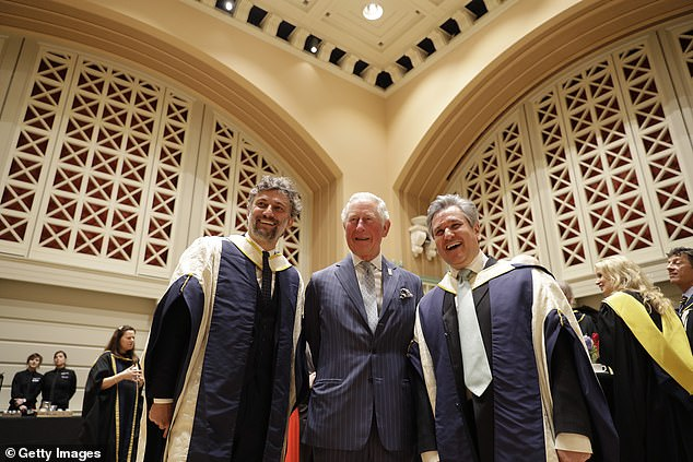 The Prince of Wales smiles alongside r Jonas Kaufmann (L) and English-Italian conductor and pianist Sir Antonio Pappano (R) after presenting them with honorary Doctor of Music awards