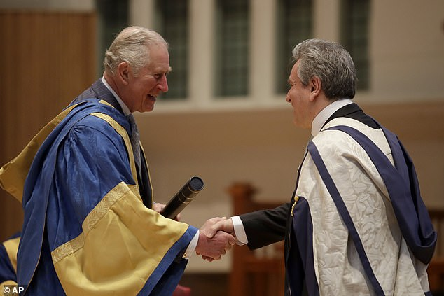 The Prince of Wale handed out the awards in his role as president of the Royal College of Music (RCM). Pictured, presenting English-Italian conductor and pianist Sir Antonio Pappano with an honorary Doctor of Music award