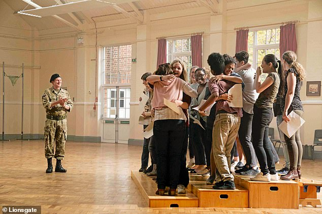 The story of the real-life Military Wives choir starts back in 2010, when group of wives and girlfriends left in the UK while their partners were deployed in Afghanistan formed a choir. Pictured, the women come together to sing in a scene from the film