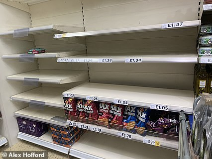 Shelves in this London Tesco is empty of pasta, pasta sauces, rice and other staples but crisps and chocolate oranges appear to have been left
