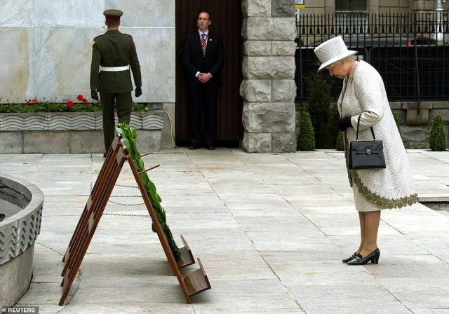 Britain's Queen Elizabeth bows after laying a wreath at the Garden of Remembrance in Dublin on May 17, 2011