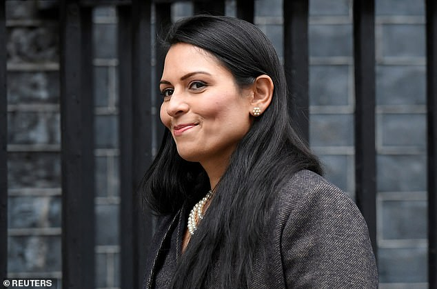 Priti Patel arrives at Downing Street in London, Britain on February 13, 2020. Sources close to the Home Secretary said it was 'ludicrous' to accuse her of being responsible for the woman's legal case against the Government, arguing that it had started long before Miss Patel took office